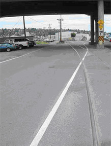 Ballard neighborhood bicycle lawsuit against Seattle for hazardous road too many cyclist crashes on railroad track road angle
