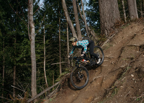 Seattle bicycle lawyer Jessica Cutler riding her mountain bike down a steep decent in Washington.
